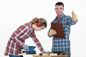 Couple working at a workbench